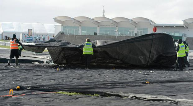 12 March: The protective covers are removed from the racecourse ahead of the first day's racing at Cheltenham