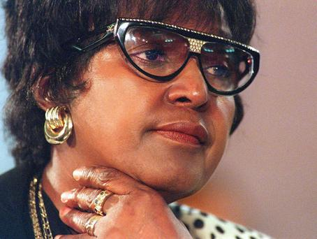 In this Nov. 27, 1997 file photo Winnie Madikizela Mandela listens to evidence at Truth and Reconcilliation (TRC) hearings on Winnie Mandela's United football club in Johannesburg.