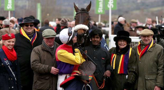 Golden Chieftain and jockey Brendan Powell after winning the JLT Specialty Handicap Chase during Champion Day of the 2013 Cheltenham Festival at Cheltenham