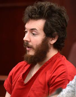 Accused Aurora theater shooting suspect James Holmes listens at his arraignment in Centennial, Colorado March 12, 2013.