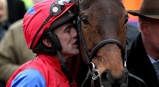Jockey Ruby Walsh with Quevega after victory in the OLBG Mares' Hurdle during Champion Day of the 2013 Cheltenham Festival
