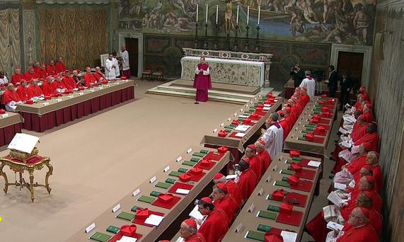 Cardinals sit in the Sistine Chapel to begin the conclave
