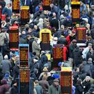 Bookmakers, during Champion Day of the 2013 Cheltenham Festival