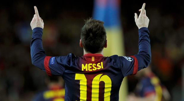 Barcelona's Lionel Messi celebrates after scoring his second