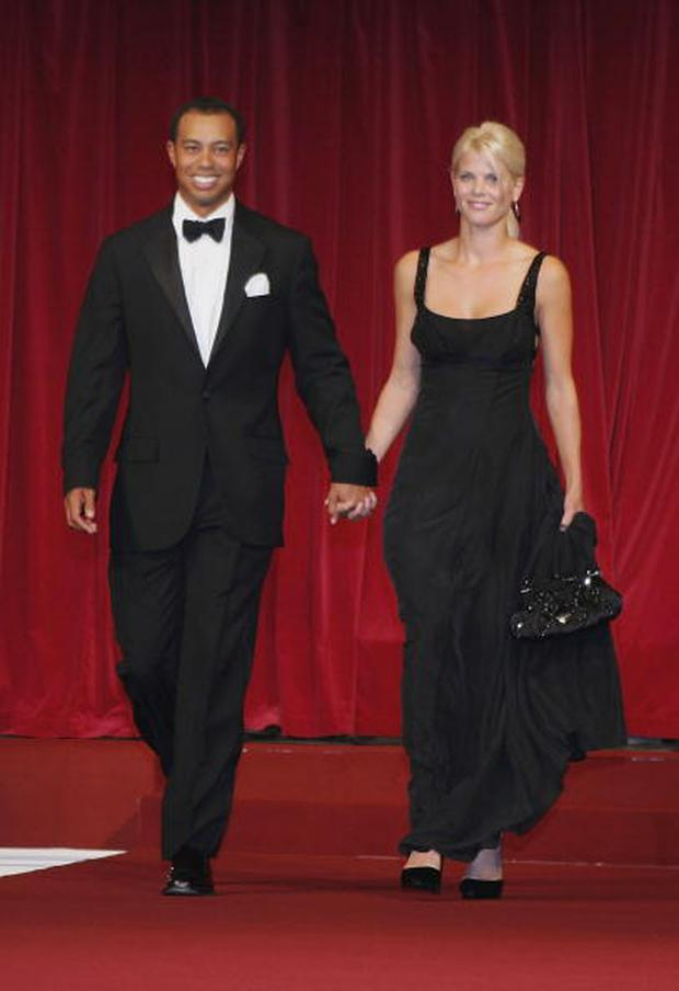 Tiger Woods and his wife Elin walk down the catwalk during the Ryder Cup Gala Dinner at Citywest Hotel and Golf Resort September 20, 2006 in Dublin, Ireland. (Photo by Andrew Redington/Getty Images)