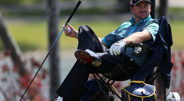 Graeme McDowell, pictured here taking a break at Doral, has impressed his mind coach, Karl Morris, so far this year