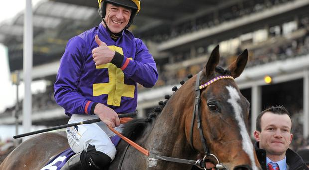 Jockey Davy Russell celebrates after winning the RSA Chase on Lord Windermere. Cheltenham Racing Festival 2013