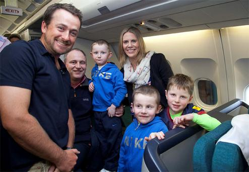 Golfer Graeme McDowell with the O'Mahony family on board the plane in Orlando