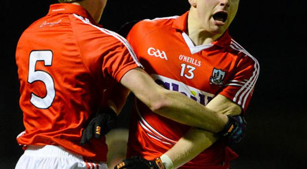 Cork's duo Brian Hurley, left, and TJ Brosnan celebrate at the final whistle after beating Kerry in Pairc Ui Rinn