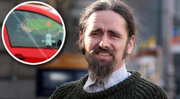 Luke 'Ming' Flanagan says he will not resign as a TD. Inset: The TD on his phone whilst in his car