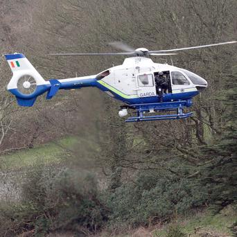 A Garda helicopter was called in to assist the pursuit of armed robbers in Dublin