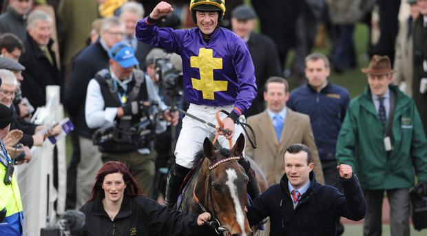 Davy Russell celebrates on Lord Windermere after winning the RSA Chase during Ladies Day
