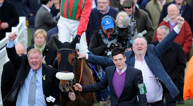 Jockey Bryan Cooper on Benefficient, which won the Jewson Novices Chase, celebrates with owners Adrian Shiels (left) and Niall Reilly