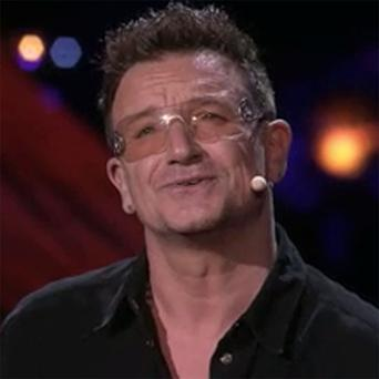 Bono addresses the audience at TED 2013 in Long Beach, California.