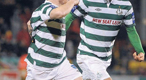 Gary McCabe (left) celebrates alongside his Shamrock Rovers team-mate James Chambers after scoring their second goal