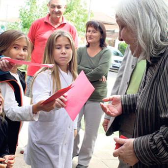Maria Elena Bergoglio, sister of Pope Francis, receives letters from children for her brother as she arrives at her home in Buenos Aires.