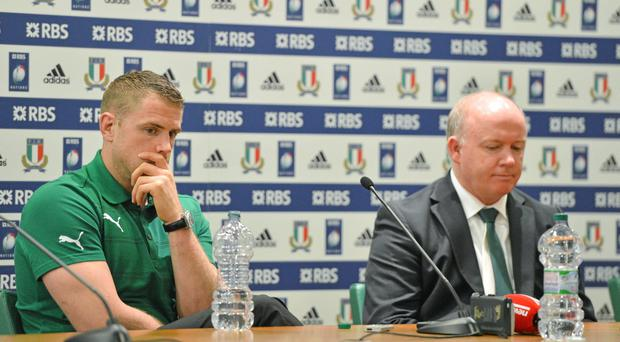 Ireland captain Jamie Heaslip, left, and head coach Declan Kidney during the post match press conference after the game.
