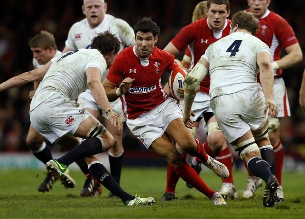 Wales' Mike Phillips(C) runs with the ball during their Six Nations international rugby union match against England at the Millennium Stadium