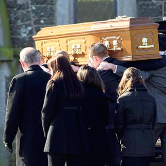 The coffin of Peter Butterly is carried into St Colmcille's Church in Togher, Co Louth. Photo