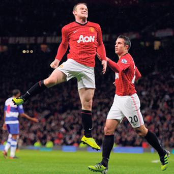 Wayne Rooney celebrates scoring against Reading at Old Trafford