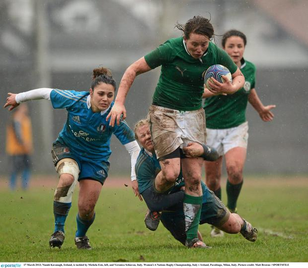 Niamh Kavanagh, Ireland, is tackled by Michela Este, left, and Veronica Schiavon, Italy.