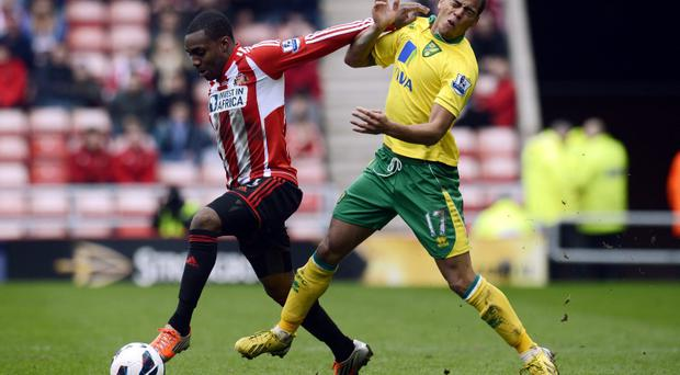 Sunderland's Danny Rose and Norwich City's Elliott Bennett (right) during the Barclays Premier League match at the Stadium of Light