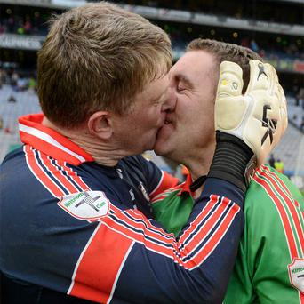 Shane Curran (left) celebrates the St Brigid's win with Frankie Dolan