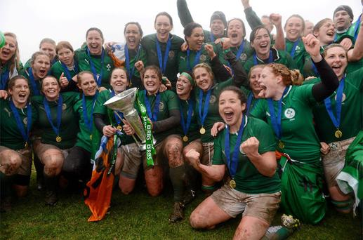 Captain Fiona Coghlan lifts the trophy surrounded by her team