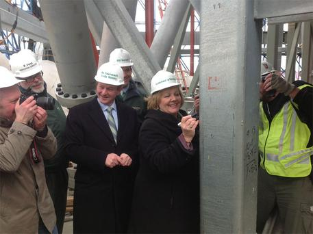 Taoiseach Enda Kenny and his wife Fionnuala sign a steel girder at the top of the new World Trade Centre