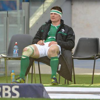 Brian O'Driscoll looks on from the sinbin during Ireland's defeat to Italy