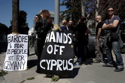 A group of demonstrators hold an anti-bailout rally outside the parliament in Nicosia today. Photo: Reuters