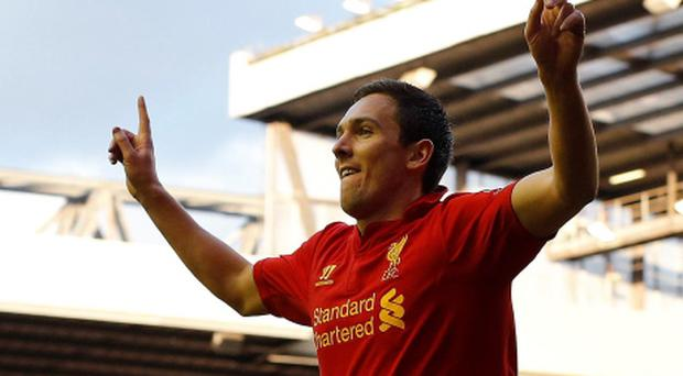 Liverpool's Stewart Downing celebrates scoring against Tottenham Hotspur at Anfield