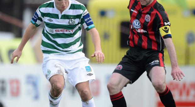 Karl Sheppard, Shamrock Rovers, in action against Owen Heary, Bohemians. Photo: Sportsfile