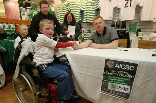 Celtic Manager Neil Lennon meets fans Hayden McLafferty (8), his brother Riley (5), and father Tommy as he signed copies of his new book