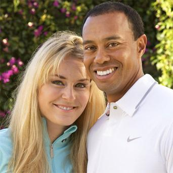 Tiger Woods and skier Lindsey Vonn pose for a portrait. Two months after rumors began circulating in Europe, Woods and Vonn posted separate items on their Facebook pages Monday