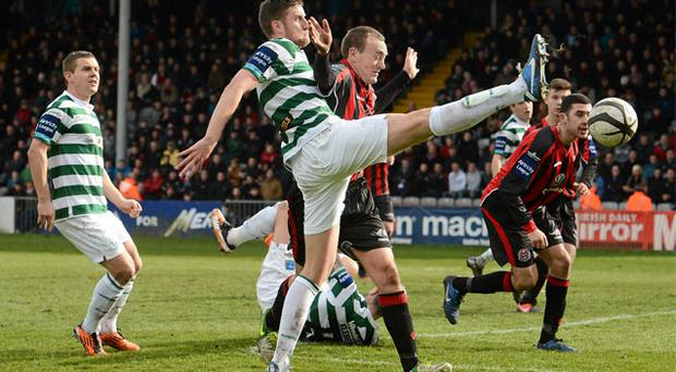 Jason McGuinness puts his best foot forward as he battles it out with Dave Scully at Dalymount Park