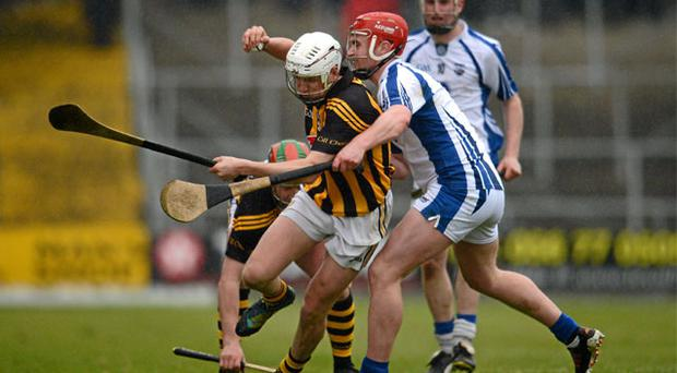 Lester Ryan, Kilkenny, in action against Pauric Mahony, Waterford.