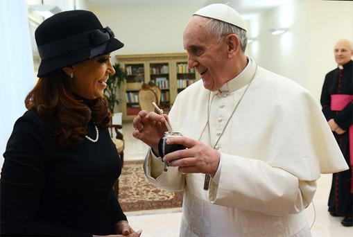 Newly elected Pope Francis holds a mate given to him from Argentine President Cristina Kirchner at the Vatican