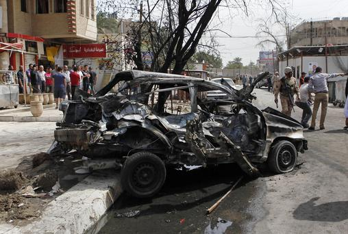 A wave of bombings tore through Baghdad on Tuesday, killing and wounding scores of people, police said, highlighting increasing sectarian tensions on the eve of the 10th anniversary of the U.S.-led war.