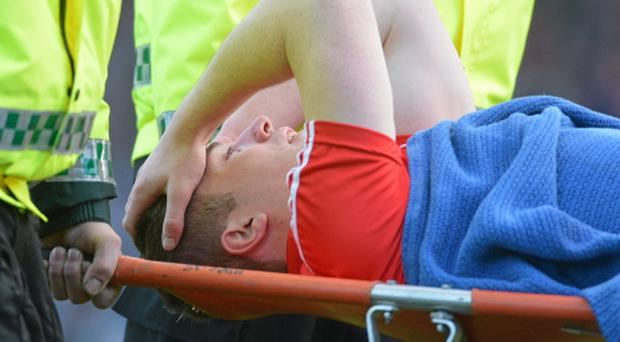 Colm O'Neill is stretchered off the pitch after picking up his injury. Photo: Sportsfile