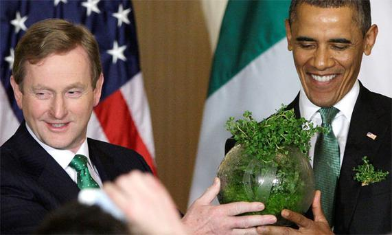 Enda Kenny gives a gift of an etched bowl filled with shamrock to US President Barack Obama at the White House