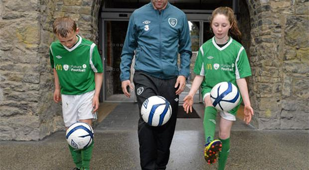 Ireland captain Robbie Keane was unveiled as ambassador for the McDonald's FAI Future Football programme and goes through his paces with Brian McManus and Cliona Fitzpatrick in Malahide yesterday
