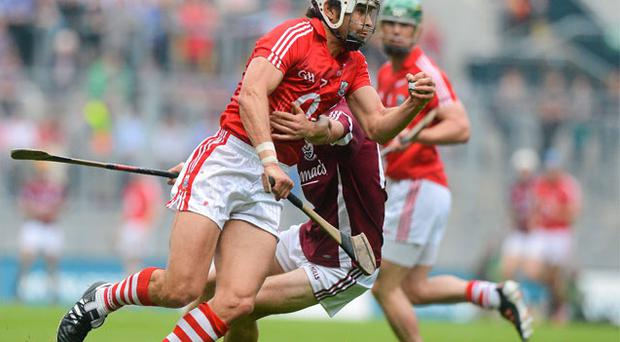 Seán Óg Ó hAilpín takes on Galway's David Burke in what proved to be his final game for Cork last August