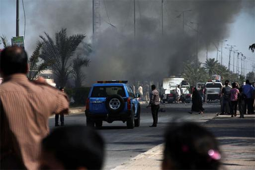 Smoke rises from the site of a bomb attack in Baghdad's Sadr City