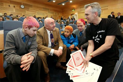 Working it out: At the Dr Maths Workshop in Engineers Ireland were students from Marian College, from left, Edward Dunne (12), Ruairi Quinn TD, Minister for Education and Skills, Jordan Byrne (12), Cian Colclough (13) and Dr Maths