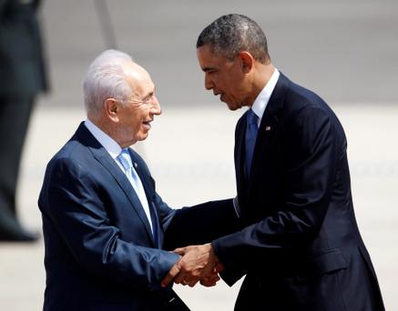 Barack Obama (R) is greeted by Israel's President Shimon Peres after landing at Tel Aviv. Photo: Reuters