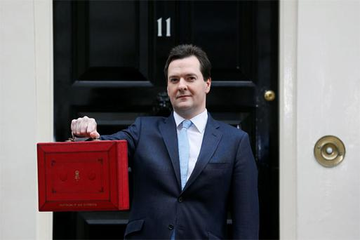 Britain's Chancellor of the Exchequer George Osborne said it would take longer than previously thought to cut the UK's debt