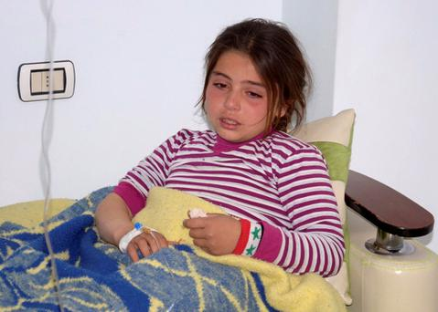 A girl, injured in what the government said was a chemical weapons attack, is treated at a hospital in the Syrian city of Aleppo March 19, 2013.