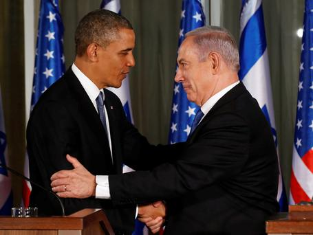 U.S. President Barack Obama and Israel's Prime Minister Benjamin Netanyahu shake hands while they hold a joint news conference at the Prime Minister's residence in Jerusalem