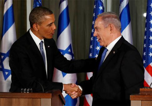 President Barack Obama and Israel's Prime Minister Benjamin Netanyahu shake hands while they hold a joint news conference at the Prime Minister's residence in Jerusalem